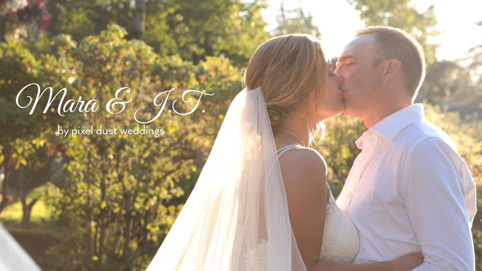 Newlywed couple during golden hour kiss for photo during wedding videography in washington
