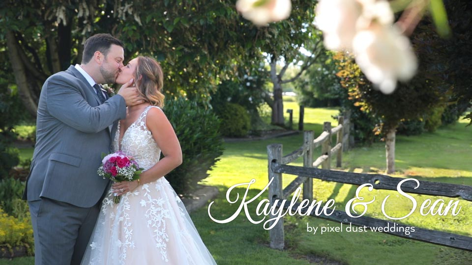 Newlywed couple poses for photo during wedding videography at Craven Farm in washington